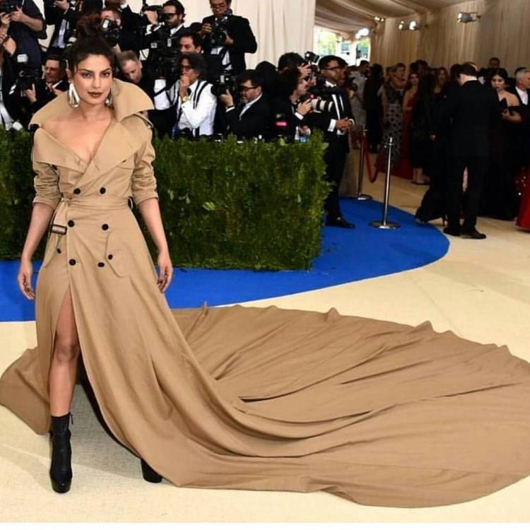 Met-Gala-2017-Priyanka-Chopra-dons-the-longest-trench-coat-and-looks-fierce-AF.jpg
